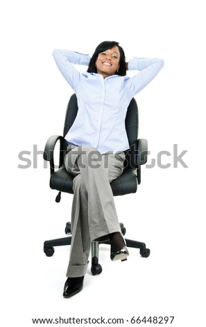 Young smiling black businesswoman relaxing sitting in leather office chair