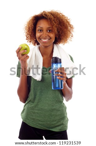 Young smiling black woman holding bottle of water and apple isolated over white background