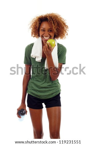 Young smiling black woman holding bottle of water and apple isolated over white background - stock photo