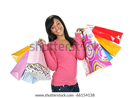 Young smiling black woman holding colorful shopping bags - stock photo