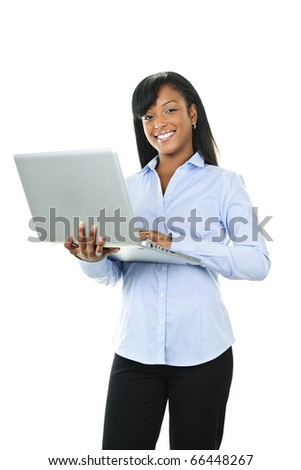 Young smiling  black woman standing with laptop computer - stock photo