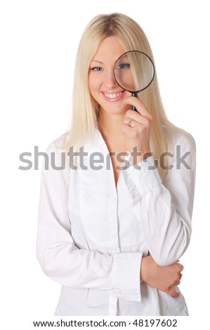 Young smiling blonde in a white shirt  with a magnifying glass in hand - stock photo