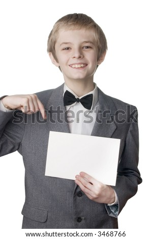 Young smiling boy holding on blank card. Very useful place for the text inserting - stock photo