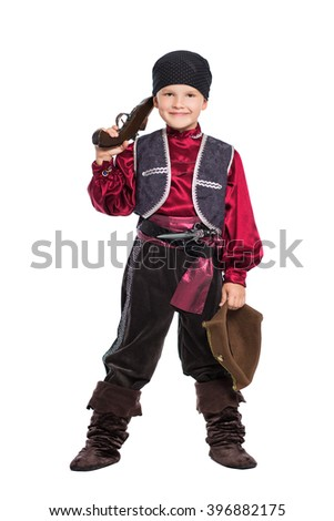 Young smiling boy posing in pirate costume. Isolated on white