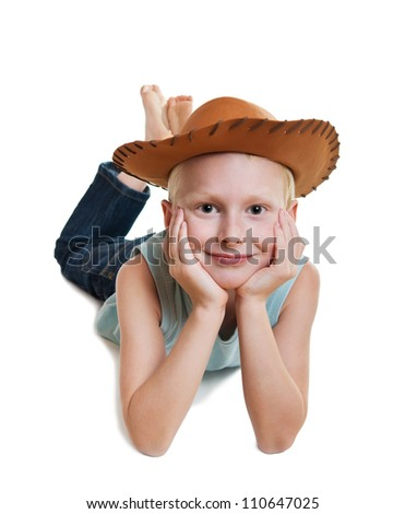 young smiling boy wearing cowboy hat, isolated on white - stock photo