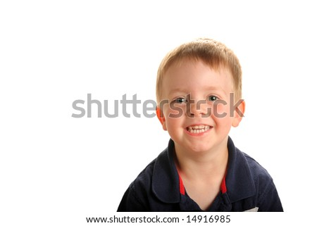 Young smiling boy with green eyes and blonde hair