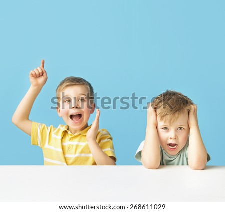 Young smiling brothers - stock photo
