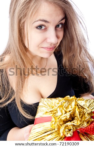 Young smiling brunette girl with big gift