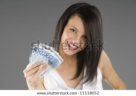 young smiling brunette with a wad 20 euro in her hand
