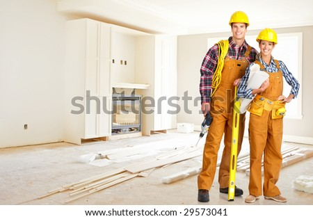Young smiling builder people in yellow uniform - stock photo