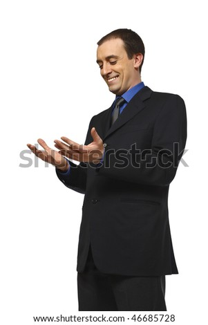 young smiling business man loo his hands isolated on white