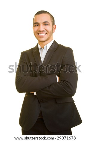 Young smiling business man with arms crossed - stock photo