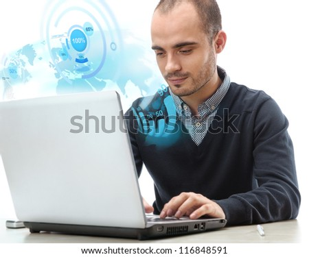 Young smiling business man working with virtual interface of world map on his laptop isolated
