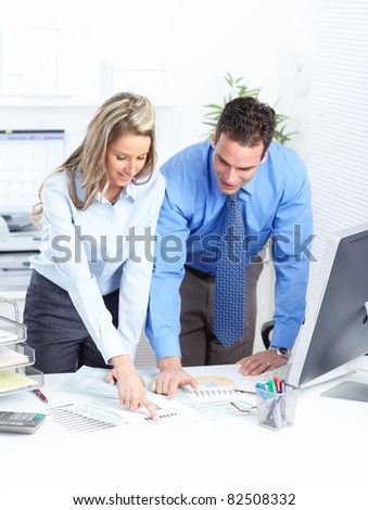 Young smiling business people in modern office.