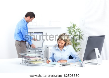 Young smiling business people in modern office. - stock photo