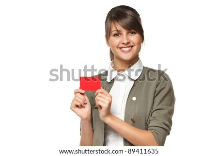 Young smiling business woman holding credit card isolated on white background
