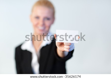 Young smiling Business woman holding out a business card - stock photo
