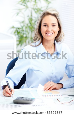 Young smiling business woman in modern office.