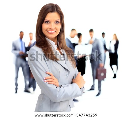 Young smiling business woman in the foreground - stock photo