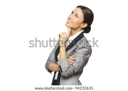 Young smiling business woman looking upwards at blank copy space, isolated on white background