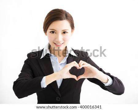 Young smiling business woman making heart shape - stock photo