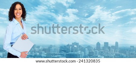 Young smiling Business woman over blue background - stock photo