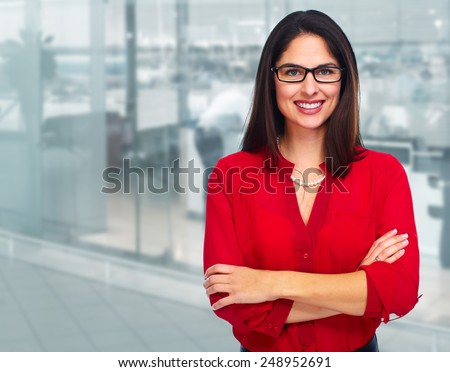 Young smiling business woman over office background. - stock photo