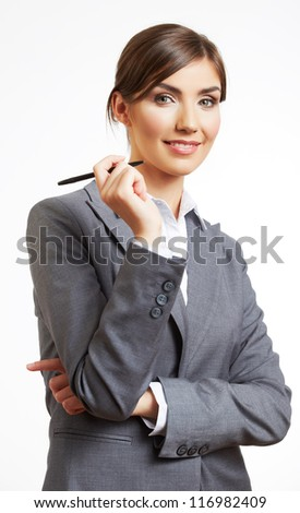 Young smiling business woman standing against white background. Business female  model hold black pen. - stock photo
