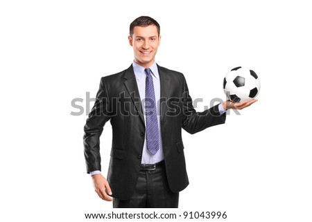 Young smiling businessman holding a football isolated on white background - stock photo