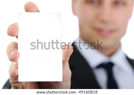 Young smiling businessman holding in hand vertical card for your company name, copy-space, look at more photos and ideas in my portfolio - stock photo