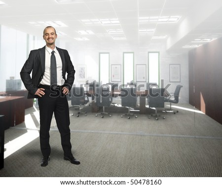 young smiling businessman standing 3d  in office - stock photo