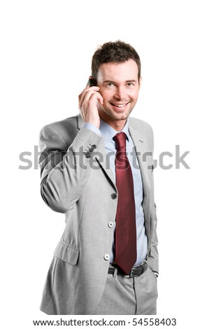 Young smiling businessman talking on mobile isolated on white background - stock photo