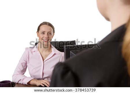Young Smiling Businesswoman Interviewing Candidate For Job In Office