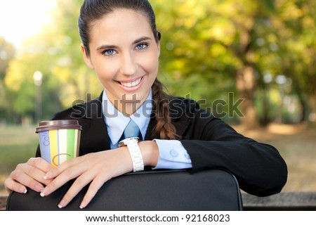 young, smiling businesswoman on cafe break, outdoor - stock photo