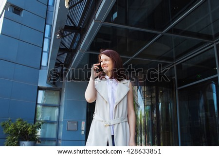 Young smiling businesswoman,student professional outdoors talking on cell, smart phone.Businesswoman smiling,Life style,