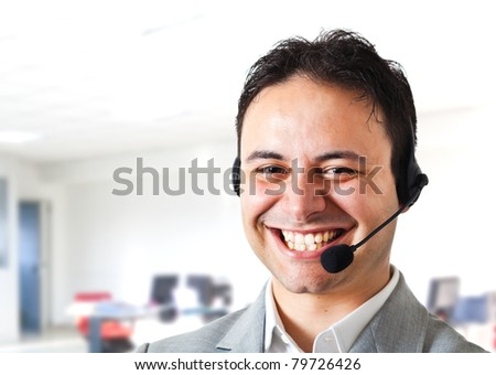 Young smiling call center operator - stock photo