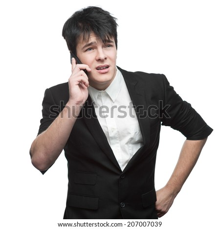 young smiling caucasian brunette businessman isolated on white background talking on cell phone - stock photo