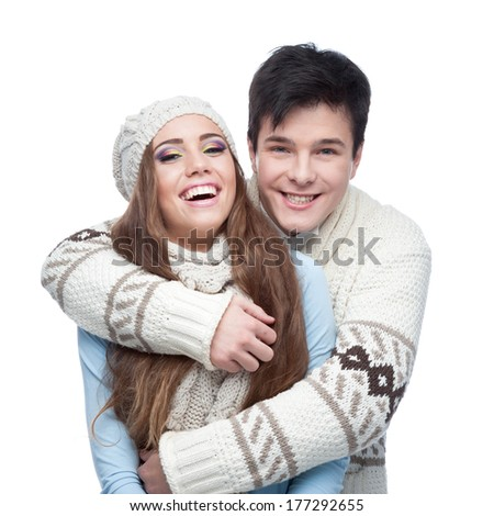 young smiling caucasian brunette couple in winter clothing embracing - stock photo