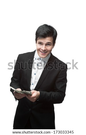 young smiling caucasian businessman in black suit holding money isolated on white - stock photo