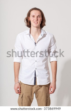 Young smiling caucasian guy on bright background
