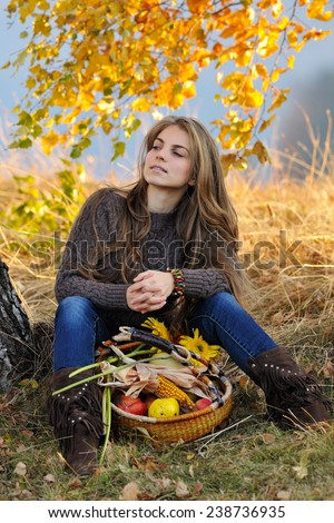 young smiling caucasian woman outdoor in autumn - stock photo