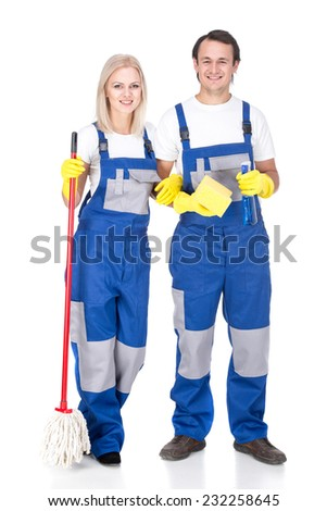 Young smiling cleaner man and woman. Housework. Isolated on white background. - stock photo