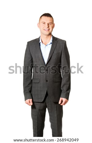 Young smiling confident businessman standing. - stock photo
