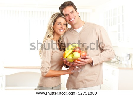 Young smiling couple at modern home - stock photo