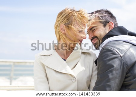 Young smiling couple at Pier