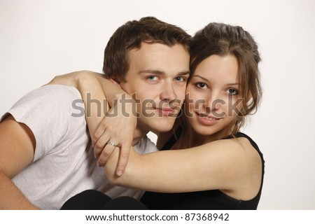 Young smiling couple on white background