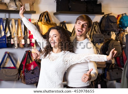 Young smiling couple shopping in haberdashery shop  - stock photo