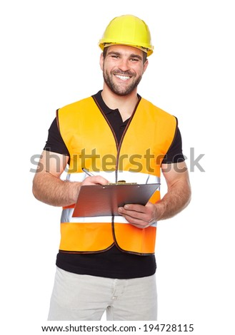 Young smiling engineer writes on a black folder, isolated on white background - stock photo