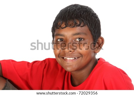 Young smiling ethnic teenage boy in studio with red tee shirt
