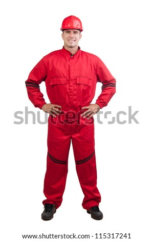 Young smiling fireman or construction worker with hard hat and in full uniform isolated on white. - stock photo